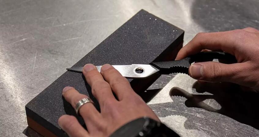 Sharpen Scissors with stone
